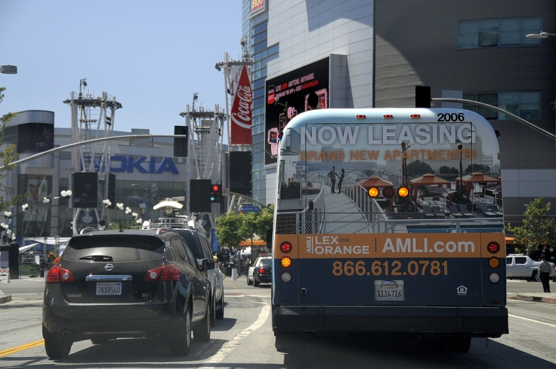 Los Angeles Downtown Bus Tail Fullback Billboard Ad for AMLI Lex on Orange as it drives by the Los Angeles Convention Center / LA Live / The Nokia Theatre